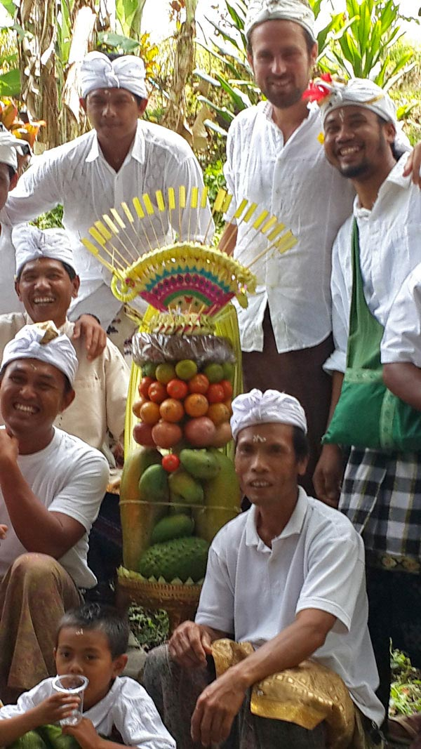 Bali Silent Retreat staff with their offering made completely of foods from the garden.